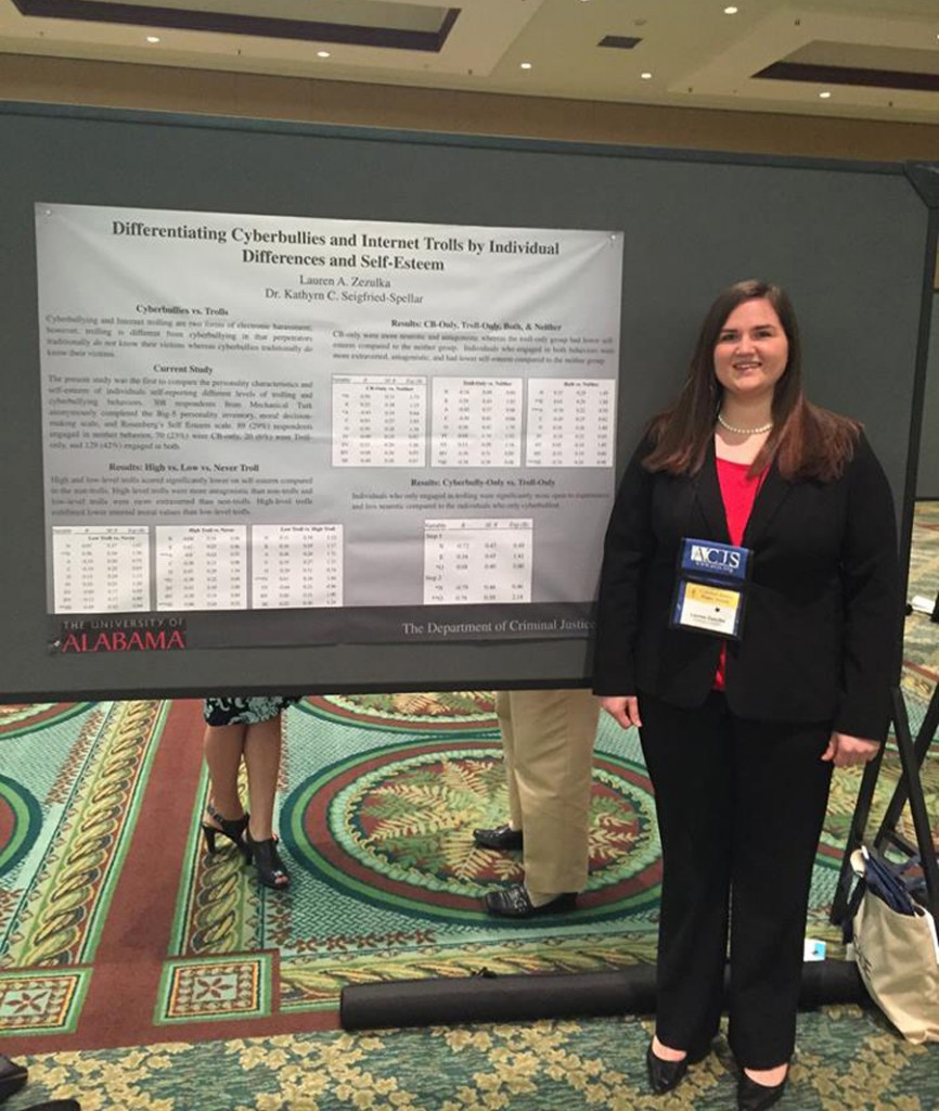 a CJ graduate student presenting her poster at a conference