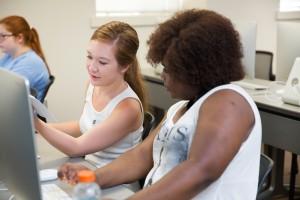 two young women in class