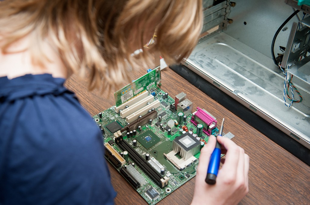 student working on computer equipment